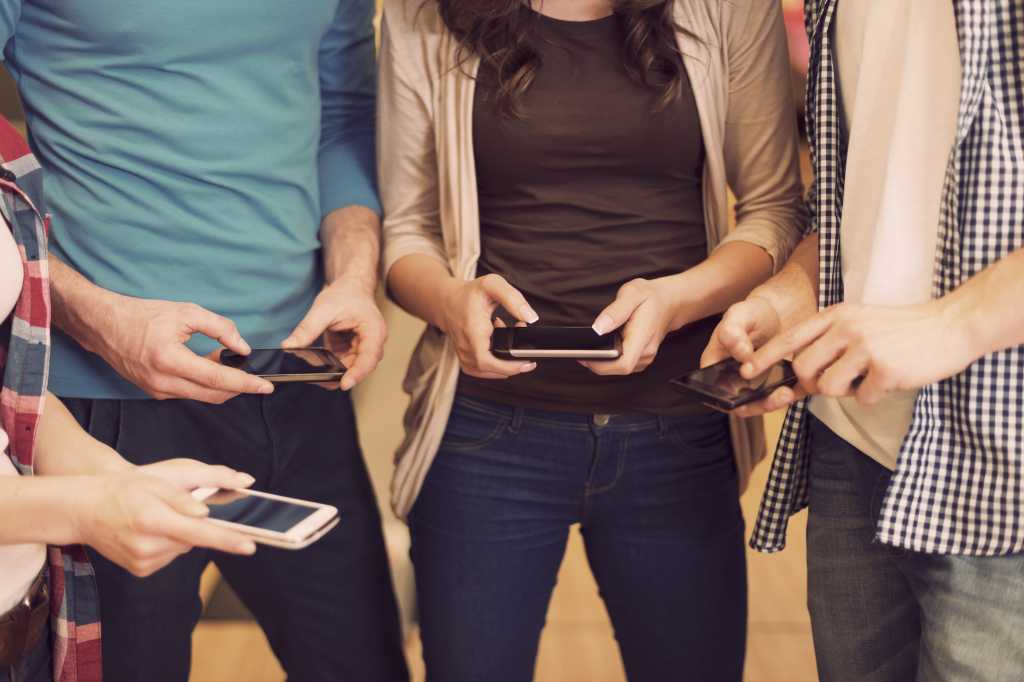 friends using iphone smartphones mobile facebook app