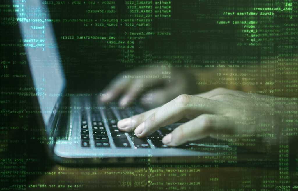 programmer hacker laptop with raining binary