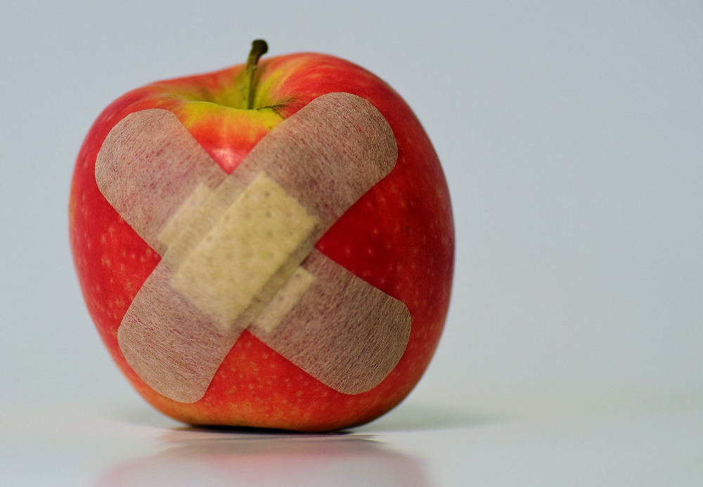 Apple with bandaids